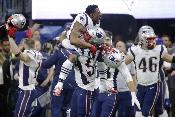 New England Patriots' Dont'a Hightower (54) gives a lift to a teammate as they celebrate winning the NFL Super Bowl 53 football game 13-3 over the Los Angeles Rams, Sunday, Feb. 3, 2019, in Atlanta. The Patriots won 13-3. (AP Photo/Patrick Semansky)