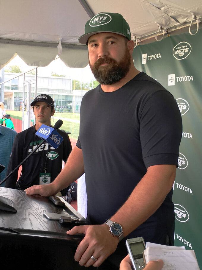 "FILE - In this Saturday, Aug. 3, 2019 file photo, Ryan Kalil was introduced after signing a one-year deal with the New York Jets at the Jets' facility in Florham Park, NJ. Ryan Kalil has had one whirlwind of a month. From retirement to a new team in a new city with new teammates and coaches in just four weeks. And, now, the New York Jets center is nearly ready to play again. ""I feel like I'm getting my legs back,"" Kalil said Tuesday, Aug. 27, 2019. (AP Photo/Dennis Waszak, File)"