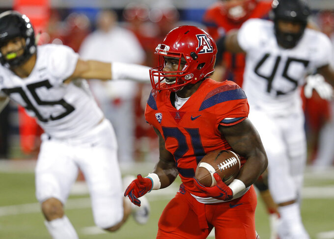 Arizona running back J.J. Taylor (21) runs for a first down in the second half during an NCAA college football game against Oregon, Saturday, Oct. 27, 2018, in Tucson, Ariz. Arizona defeated Oregon 44-15. (AP Photo/Rick Scuteri)