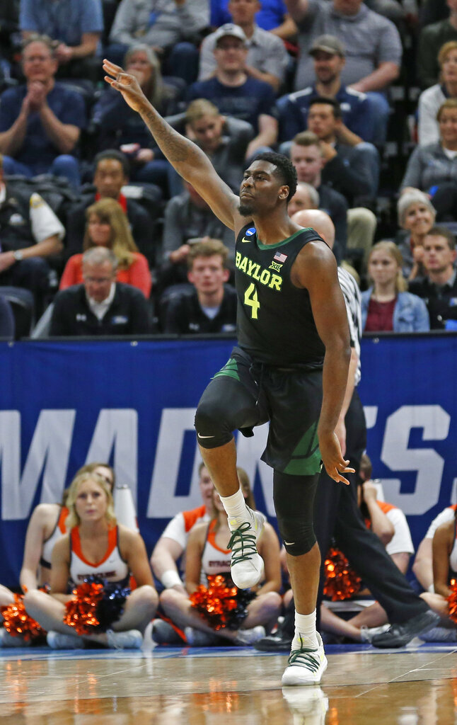 Baylor guard Mario Kegler (4) celebrates after scoring a 3-pointer against Syracuse during the first half of a first-round game in the NCAA men's college basketball tournament Thursday, March 21, 2019, in Salt Lake City. (AP Photo/Rick Bowmer)
