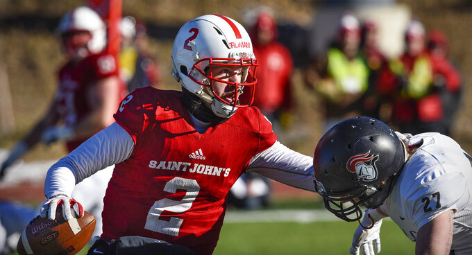 In this Nov. 17, 2018, file photo, St. John's quarterback Jackson Erdmann looks for a receiver during the first half of an NCAA college football game against Martin Luther College in Collegeville, Minn. Erdmann was named to The Associated Press Division III All-America Team, Thursday, Dec. 13, 2018.  (Dave Schwarz/St. Cloud Times via AP)