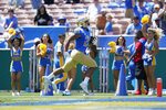 UCLA Bruins running back Zach Charbonnet (24) runs to the end zone for a touchdown during the first half of an NCAA college football game against the Hawaii Warriors Saturday, Aug. 28, 2021, in Pasadena, Calif. (AP Photo/Ashley Landis)