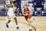 Boston College's Rich Kelly (22) drives with pressure from Notre Dame's Trey Wertz (2) during the first half of an NCAA college basketball game Saturday, Jan. 16, 2021, in South Bend, Ind. (AP Photo/Robert Franklin)