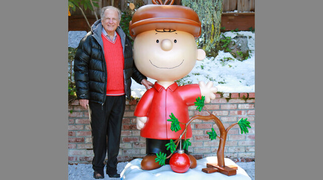This 2015 photo provided by Jason Mendelson shows Lee Mendelson in Hillsborough, Calif. Lee Mendelson, the producer who changed the face of the holidays when he brought