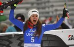 Italy's Sofia Goggia celebrates after winning an alpine ski, women's World Cup downhill in Bad Kleinkirchheim, Austria, Sunday, Jan. 14, 2018. (AP Photo/Marco Trovati)