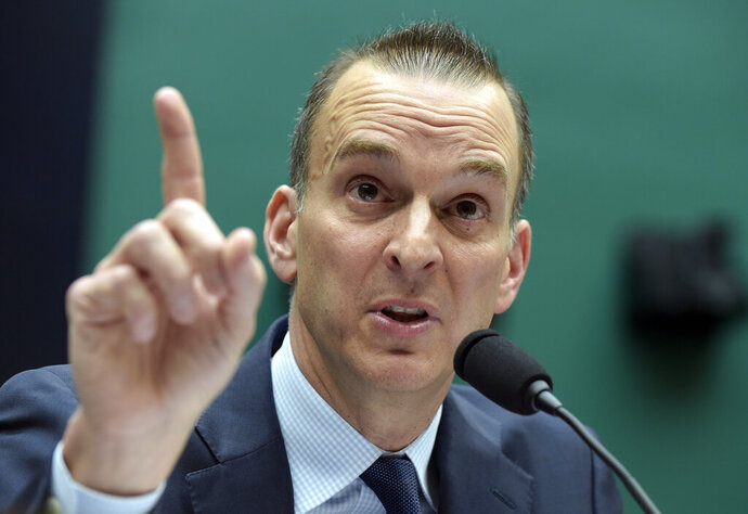 CORRECTS SPELLING OF LAST NAME TO KOLOBKOV INSTEAD OF KOLOBOV - FILE - In this Feb. 28, 2017, file photo, Travis Tygart, the chief executive officer of the U.S. Anti-Doping Agency, testifies on Capitol Hill in Washington. Speeches by representatives from the U.S. and Russia delivered Wednesday, Nov. 6, 2019, in Poland, illustrated the wide gap in perceptions about the Russian doping scandal that has upended Olympic sports. Tygart said Russia can no longer be allowed to steal medals from clean athletes. A few minutes later, Russian sports minister Pavel Kolobkov said Russia has paid the price for its misdeeds and should be welcomed back into the fold. Russia is under threat of missing the Tokyo Olympics.  (AP Photo/Susan Walsh, File)