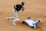 Minnesota Twins' Alex Kirilloff, right, steals second on a wild pitch by Lance Lynn as Chicago White Sox shortstop Tim Anderson (7) catches the throw in the fourth inning of a baseball game Wednesday, July 7, 2021, in Minneapolis. (AP Photo/Jim Mone)