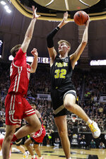 Purdue center Matt Haarms (32) shoots over Wisconsin forward Nate Reuvers (35) during the second half of an NCAA college basketball game in West Lafayette, Ind., Friday, Jan. 24, 2020. (AP Photo/Michael Conroy)