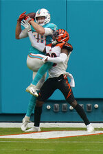 Miami Dolphins tight end Mike Gesicki (88) grabs a pass for a touchdown as Cincinnati Bengals cornerback LeShaun Sims (38) defends, during the second half of an NFL football game, Sunday, Dec. 6, 2020, in Miami Gardens, Fla. (AP Photo/Lynne Sladky)