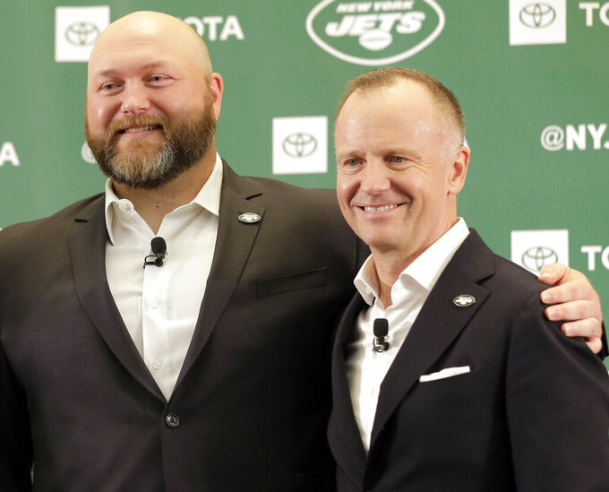 FILE - In this June 11, 2019, file photo, new New York Jets general manager Joe Douglas, left, poses for a photo with owner Christopher Johnson during a news conference at the team's NFL football training facility in Florham Park, N.J. Johnson said the search for a new head coach will be a collaborative effort between him, Douglas and team president Hymie Elhai, but Douglas will take the lead in finding the next hire. (AP Photo/Seth Wenig, File)