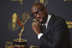 """J.B. Smoove poses with the award for outstanding actor in a short form comedy or drama series for """"Mapleworth Murders"""" on night two of the Creative Arts Emmy Awards on Sunday, Sept. 12, 2021, in Los Angeles. (Photo by Richard Shotwell/Invision/AP)"""