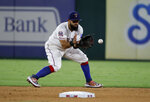 Texas Rangers second baseman Rougned Odor fields a grounder by Boston Red Sox's J.D. Martinez, who was out at first during the seventh inning of a baseball game in Arlington, Texas, Wednesday, Sept. 25, 2019. (AP Photo/Tony Gutierrez)