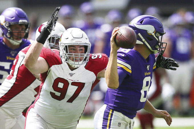 Arizona Cardinals defensive end Zach Allen (97) pressures Minnesota Vikings quarterback Kirk Cousins, right, during the first half of an NFL preseason football game, Saturday, Aug. 24, 2019, in Minneapolis. (AP Photo/Jim Mone)