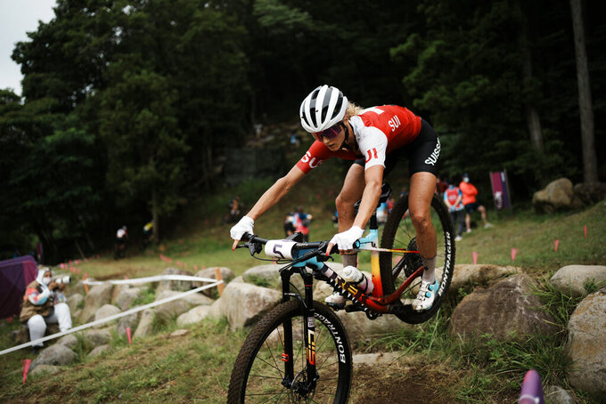 Jolanda Neff of Switzerland competes during the women's cross-country mountain bike competition at the 2020 Summer Olympics, Tuesday, July 27, 2021, in Izu, Japan. (AP Photo/Thibault Camus)