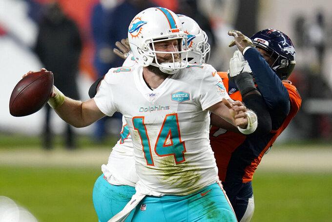 Miami Dolphins quarterback Ryan Fitzpatrick (14) throws against the Denver Broncos during the second half of an NFL football game, Sunday, Nov. 22, 2020, in Denver. The Broncos won 20-13. (AP Photo/David Zalubowski)