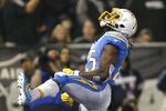 Los Angeles Chargers running back Melvin Gordon celebrates after scoring against the Oakland Raiders during the first half of an NFL football game in Oakland, Calif., Thursday, Nov. 7, 2019. (AP Photo/D. Ross Cameron)