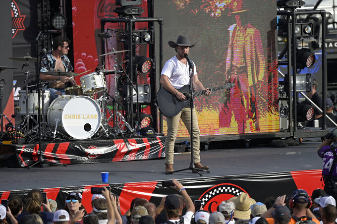 Entertainer Chris Lane performs before a NASCAR Cup Series auto race at Daytona International Speedway, Saturday, Aug. 28, 2021, in Daytona Beach, Fla. (AP Photo/Phelan M. Ebenhack)