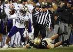 Washington running back Salvon Ahmed, left, is pushed out of bound by Colorado linebacker Nate Landman during the second half of an NCAA college football game Saturday, Nov. 23, 2019, in Boulder, Colo. Colorado won 20-14. (AP Photo/David Zalubowski)