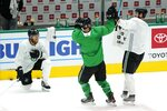 Dallas Stars' Joe Pavelski (16) laughs as Taylor Fedun (42) and Jamie Benn, right, celebrate after their squad won a shoot-out drill during NHL hockey practice in Dallas, Thursday, Jan. 21, 2021. (AP Photo/Tony Gutierrez)