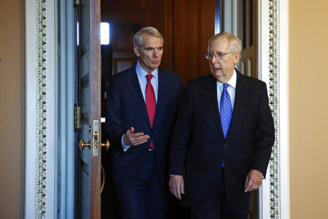 Sen. Rob Portman, R-Ohio, left, talks with Senate Majority Leader Mitch McConnell of Ky., Thursday, Dec. 19, 2019, on Capitol Hill in Washington. (AP Photo/Patrick Semansky)