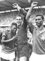 FILE - In this June 29, 1958 file photo, Brazil's 17-year-old Pele, left, weeps on the shoulder of goalkeeper Gylmar Dos Santos Neves, as Didi stands right, after Brazil's 5-2 victory over Sweden in the final of the soccer World Cup in Stockholm, Sweden. On Oct. 23, 2020, the three-time World Cup winner Pelé turns 80 without a proper celebration amid the COVID-19 pandemic as he quarantines in his mansion in the beachfront city of Guarujá, where he has lived since the start of the pandemic. (AP Photo, File)