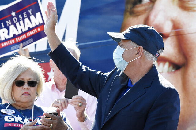 U.S. Sen. Lindsey Graham, R-S.C., waves as he arrives at a campaign rally on Saturday, Oct. 31, 2020, in Conway, S.C. (AP Photo/Meg Kinnard)