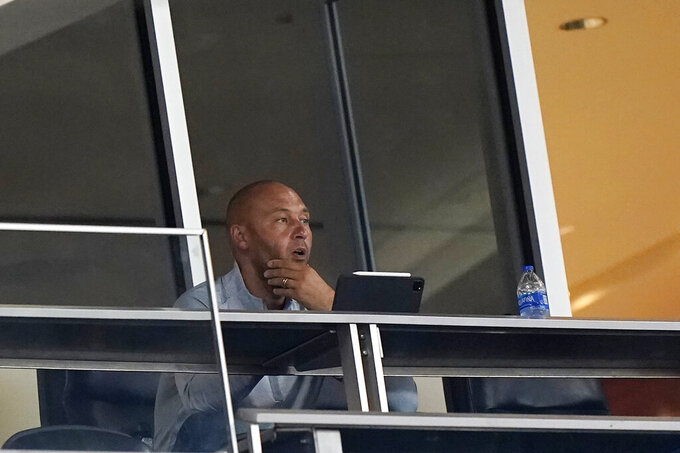 Miami Marlins CEO Derek Jeter watches during the first inning of a baseball game between the Marlins and the Atlanta Braves, Friday, Aug. 14, 2020, in Miami. (AP Photo/Wilfredo Lee)