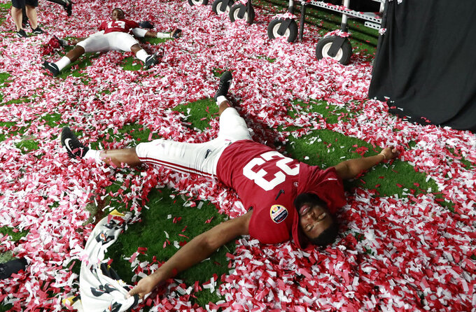 Alabama long snapper Ryan Parris (53) plays with the confetti during the Orange Bowl NCAA college football game trophy presentation, Sunday, Dec. 30, 2018, in Miami Gardens, Fla. Alabama defeated Oklahoma 45-34. (AP Photo/Wilfredo Lee)