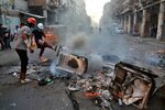 Anti-government protesters set fire and close streets while security forces fired live ammunition and tear gas in, Iraq, Monday, Nov. 4, 2019. (AP Photo/Khalid Mohammed)