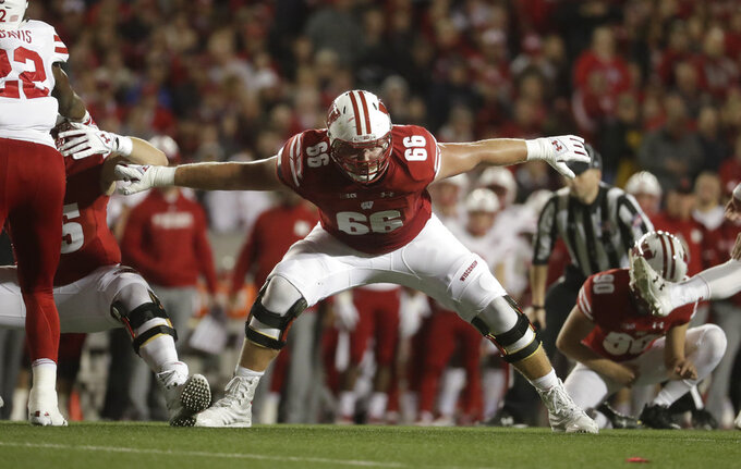 FILE - In this Oct. 6, 2018, file photo, Wisconsin's Beau Benzschawel is shown during the first half of an NCAA college football game against Nebraska, in Madison, Wis. Benzschawe; was named to The Associated Press Midseason All-America team, Tuesday, Oct. 16, 2018.(AP Photo/Morry Gash, File)