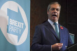 Brexit Party leader Nigel Farage speaks to the media as he launches his party's manifesto ahead of the upcoming General Election, in London, Friday, Nov. 1, 2019.  Farage kicked off the Brexit Party campaign Friday for Britain's December general election.(AP Photo/Alberto Pezzali)