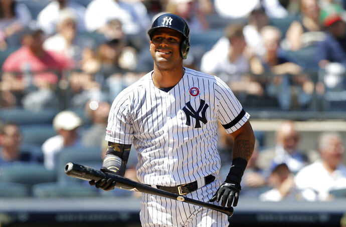 FILE - In this May 18, 2019, file photo, New York Yankees' Aaron Hicks reacts after striking out against the Tampa Bay Rays during the third inning of a baseball game in New York. Hicks will have Tommy John surgery for a partially torn ligament in his throwing elbow on Oct. 30, and is expected to be out 8 to 10 months, general manager Brian Cashman announced Thursday, Oct. 24, 2019. (AP Photo/Jim McIsaac, File)