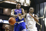 Tennessee State forward Stokley Chaffee Jr. (30) and Vanderbilt forward Simisola Shittu (11) battle for a rebound in the first half of an NCAA college basketball game Saturday, Dec. 29, 2018, in Nashville, Tenn. (AP Photo/Mark Humphrey).