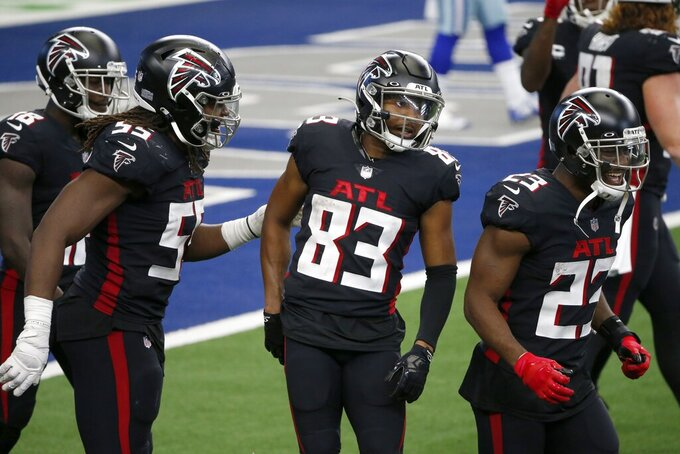 Atlanta Falcons' Steven Means (55), Brian Hill (23) and others celebrate with Russell Gage (83) after his touchdown catch in the second half of an NFL football game against the Dallas Cowboys in Arlington, Texas, Sunday, Sept. 20, 2020. (AP Photo/Michael Ainsworth)