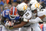 Florida tight end C'yontai Lewis (80) is stopped for a loss by Missouri defensive linemen Walter Palmore (99) and Chris Turner (39) after catching a pass during the second half of an NCAA college football game Saturday, Nov. 3, 2018, in Gainesville, Fla. (AP Photo/Phelan M. Ebenhack)