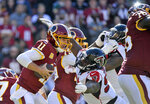 FILE - In this Nov. 4, 2018, file photo, Washington Redskins quarterback Alex Smith (11) is sacked by Atlanta Falcons defensive tackle Grady Jarrett, right, during an NFL football game in Landover, Md. The Falcons placed a franchise tag on Jarrett before the NFL deadline on Tuesday, March 5, 2019.  (AP Photo/Mark Tenally, File)