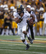 Missouri quarterback Kelly Bryant runs the ball against Wyoming in the first quarter of an NCAA college football game Saturday, Aug. 31, 2019, in Laramie, Wy. (AP Photo/Michael Smith)