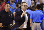 UCLA interim coach Murry Bartow celebrates as he runs off the floor after UCLA defeated Southern California in an NCAA college basketball game Thursday, Feb. 28, 2019, in Los Angeles. UCLA won 93-88 in overtime. (AP Photo/Mark J. Terrill)