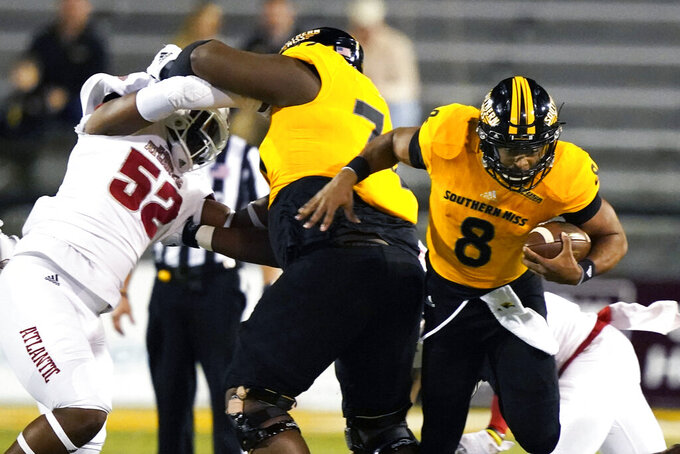 Southern Mississippi quarterback Trey Lowe (8) carries the ball for a short gain against Florida Atlantic during the first half of an NCAA college football game Thursday, Dec. 10, 2020, in Hattiesburg, Miss. (AP Photo/Rogelio V. Solis)
