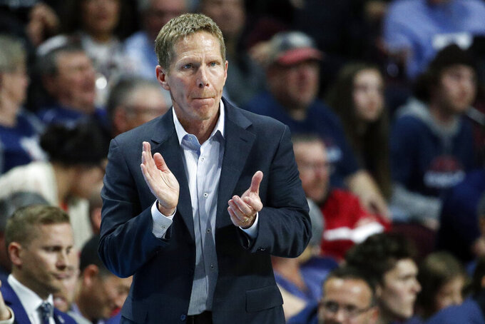 FILE - In this March 10, 2020, file photo, Gonzaga head coach Mark Few motions toward the court in the second half of an NCAA college basketball game against Saint Mary's in the final of the West Coast Conference men's tournament in Las Vegas. Gonzaga and Baylor remained Nos. 1-2 in the first Associated Press men's college basketball poll of the regular season released Monday, Nov. 30, 2020.  (AP Photo/John Locher, File)