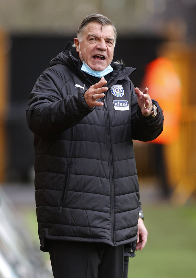 West Bromwich Albion's manager Sam Allardyce gestures during the English Premier League soccer match between Wolverhampton Wanderers and West Bromwich Albion at the Molineux Stadium in Wolverhampton, England, Saturday, Jan. 16, 2021. (Carl Recine/Pool via AP)