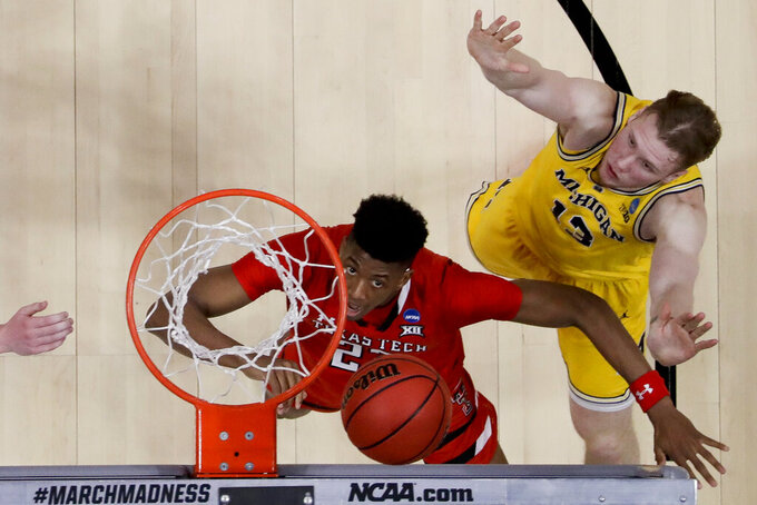 Texas Tech guard Jarrett Culver, left, and Michigan forward Ignas Brazdeikis wait for a rebound during the first half an NCAA men's college basketball tournament West Region semifinal Thursday, March 28, 2019, in Anaheim, Calif. (AP Photo/Marcio Jose Sanchez)