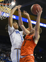 Oregon State forward Tres Tinkle, right, goes up for a shot while UCLA center Moses Brown defends during the first half of an NCAA college basketball game in Los Angeles, Thursday, Feb. 21, 2019. (AP Photo/Kelvin Kuo)