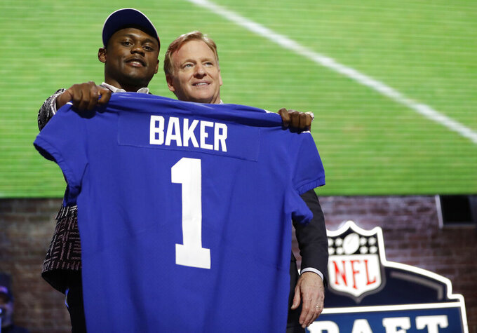 Georgia defensive back DeAndre Baker poses with NFL Commissioner Roger Goodell after the New York Giants selected Baker in the first round at the NFL football draft, Thursday, April 25, 2019, in Nashville, Tenn. (AP Photo/Mark Humphrey)