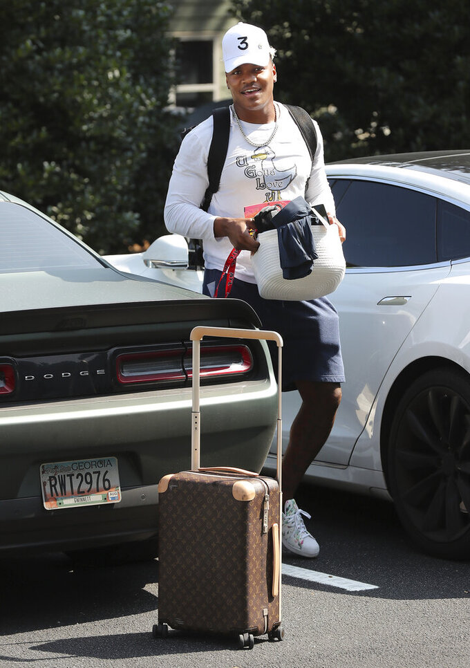 Atlanta Falcons linebacker Mykal Walker arrives for NFL football training camp in Flowery Branch, Ga., Tuesday, July 27, 2021. (Curtis Compton/Atlanta Journal-Constitution via AP)