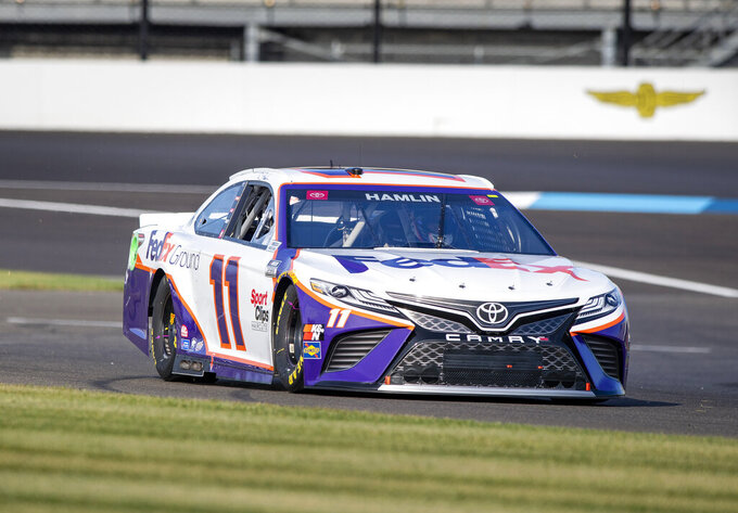 Denny Hamlin (11) during qualifying for a NASCAR Cup Series auto race at Indianapolis Motor Speedway, Sunday, Aug. 15, 2021, in Indianapolis. (AP Photo/Doug McSchooler)