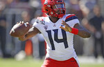 Arizona quarterback Khalil Tate passes against Stanford in the first half of an NCAA college football game Saturday, Oct. 26, 2019, in Stanford, Calif. (AP Photo/Ben Margot)