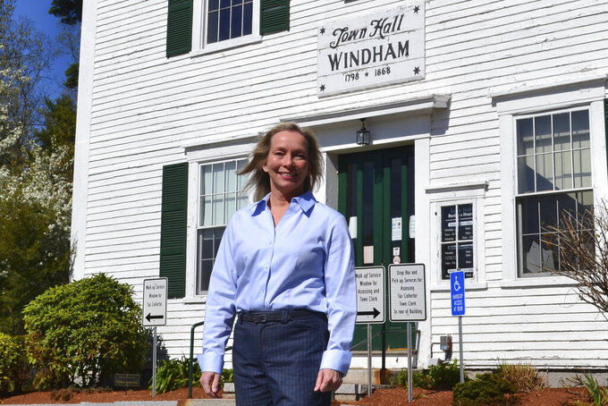 In this May 7, 2021 photo, Kristi St. Laurent, who ran for a House seat in the 2020 election, poses in front of Town Hall in Windham, N.H. St. Laurent, who requested a recount after losing the 2020 election by 24 votes, has led to a debate over the integrity of the election in Windham and prompted Trump supporters to suggest the dispute could illustrate wider problems with the election system. (AP Photo/Michael Casey)
