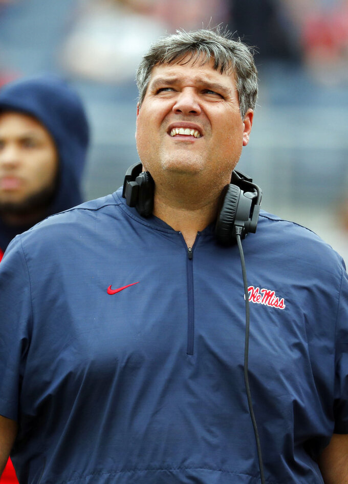 Mississippi head coach Matt Luke watches a replay of an Auburn touchdown during the second half of an NCAA college football game on Saturday, Oct. 20, 2018, in Oxford, Miss. Auburn won 31-16. (AP Photo/Rogelio V. Solis)