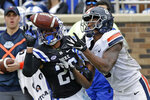 Duke safety Michael Carter II (26) and Virginia wide receiver Hasise Dubois (8) reach for a pass during the second half of an NCAA college football game in Durham, N.C., Saturday, Oct. 20, 2018. The pass was incomplete. Virginia won 28-14. (AP Photo/Gerry Broome)